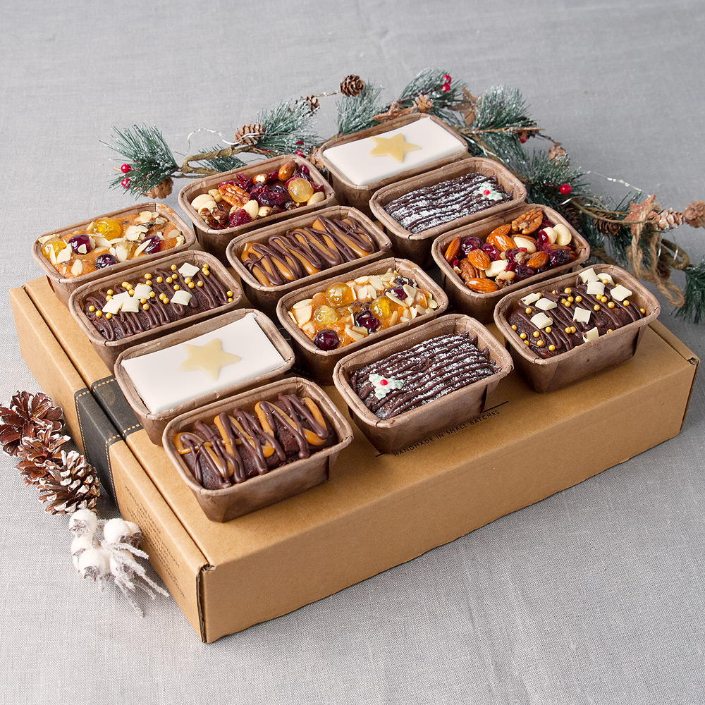 Image of This delicious assortment of cakes is perfect for sharing this Christmas! Hand-baked and hand decorated by The Original Cake Company to ensure the very best quality. Includes two each of the following cakes;