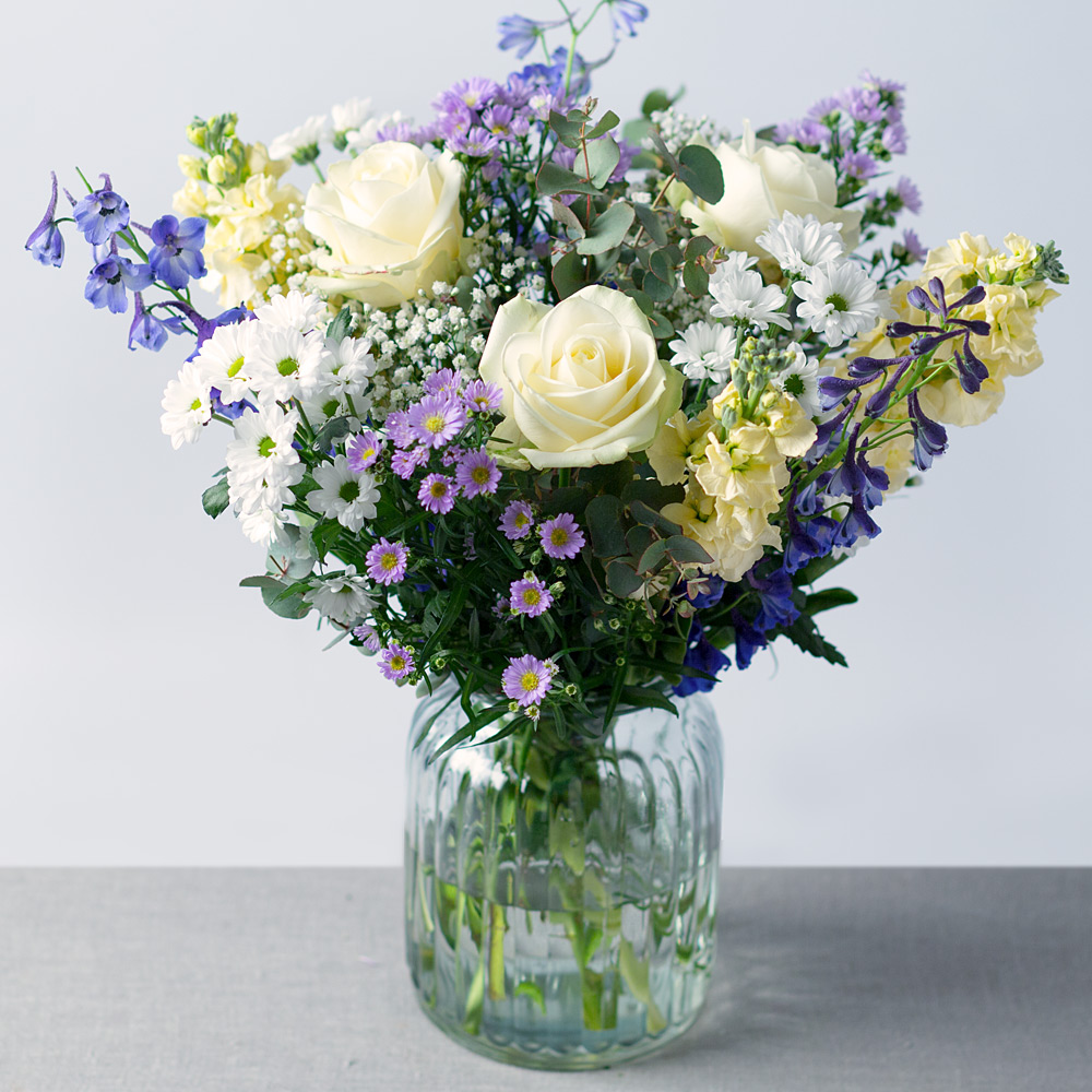Image of Beautiful white Avalanche Roses, pretty white Snapdragon and delicate lilac Aster feature in this wonderful summer bouquet.