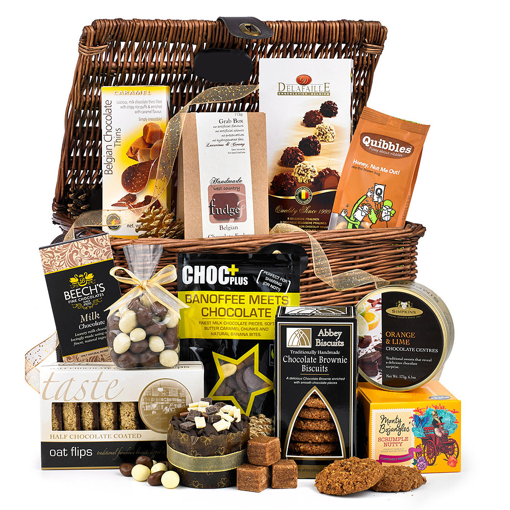 Image of Make someone's chocolate dreams come true with this tasty basket full of chocolaty goodness! With Milk & White Chocolate Coated Raisins, Belgian Chocolate Fudge, Chocolate Brownie, Half Chocolate Coated Oat Flips and Mini Chocolate Cake, the recipient is sure to be delighted with this huge chocolate feast!