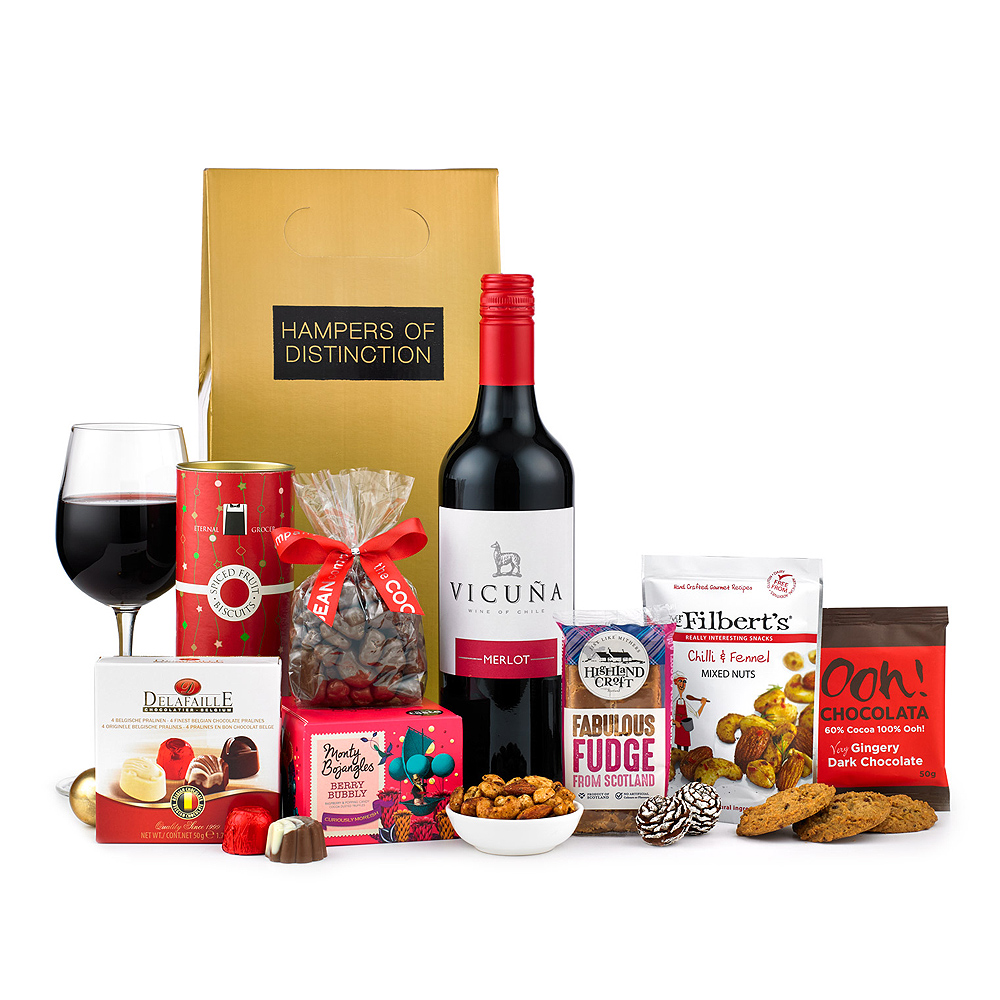 Image of This delicious assortment of festive foods includes truffles, biscuits, chocolates and a bottle of wine, making it the perfect accompaniment to your festive celebrations. 