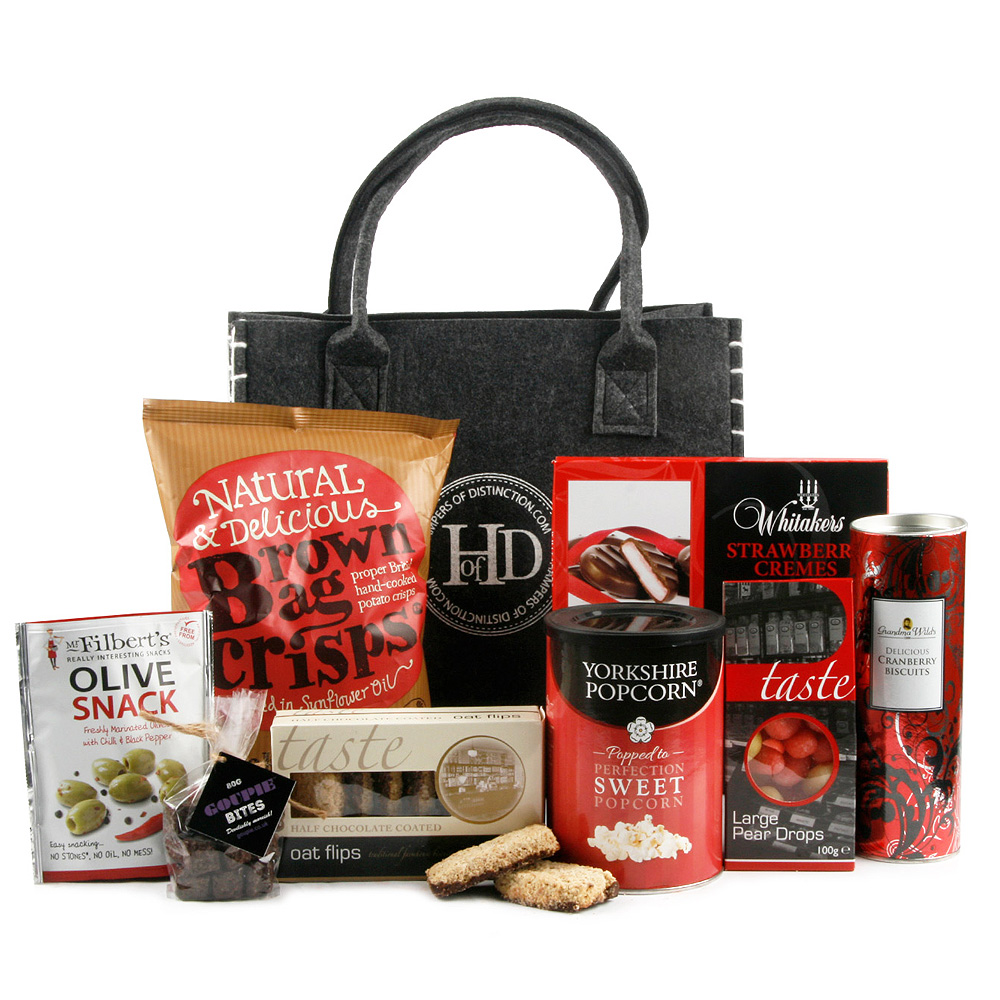 Image of This gourmet gift bag full of delicious bites is great to send as a pick-me-up to a loved one. 