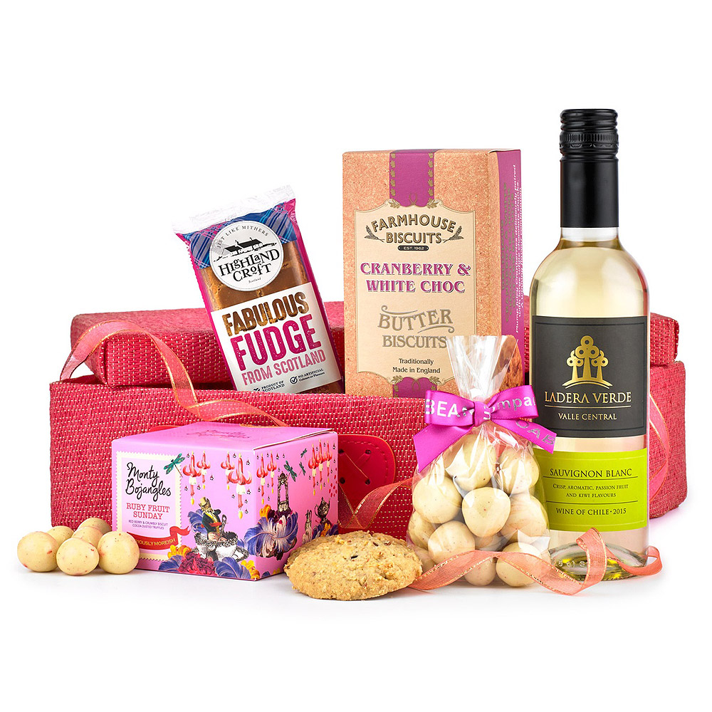Image of For those who love the colour pink, this smart pink woven gift basket will be a lovely keepsake once the tempting contents have been devoured! A perfect gift hamper for any occasion, from birthdays to a thank you gesture.