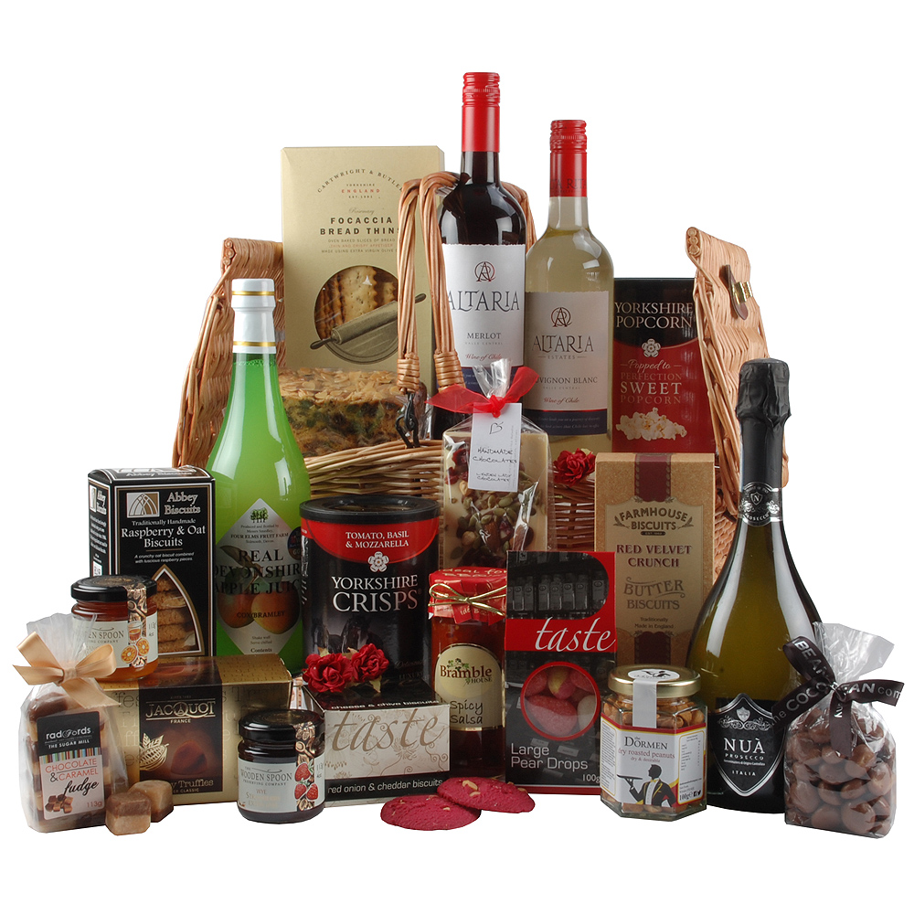 Image of A large wicker basket features biscuits, truffles, preserves and more!