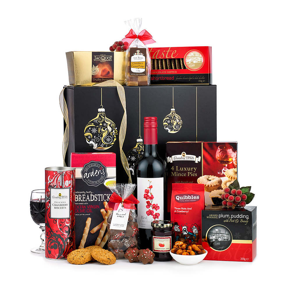 Image of This delicious gift contains an abundance of luxurious foods to suit all tastes; from the Brandy & Port Christmas Pudding to the chilli coated peanuts and fruit mince pies.
