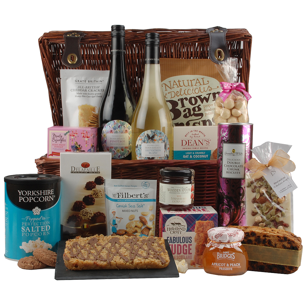 Image of A great gift to share with all the family, this hamper contains both red and white wines alongside a variety of tasty accompaniments such as Cheddar Crackers, Salted Caramel Flapjack Tray and Rich Dundee Slab Cake.