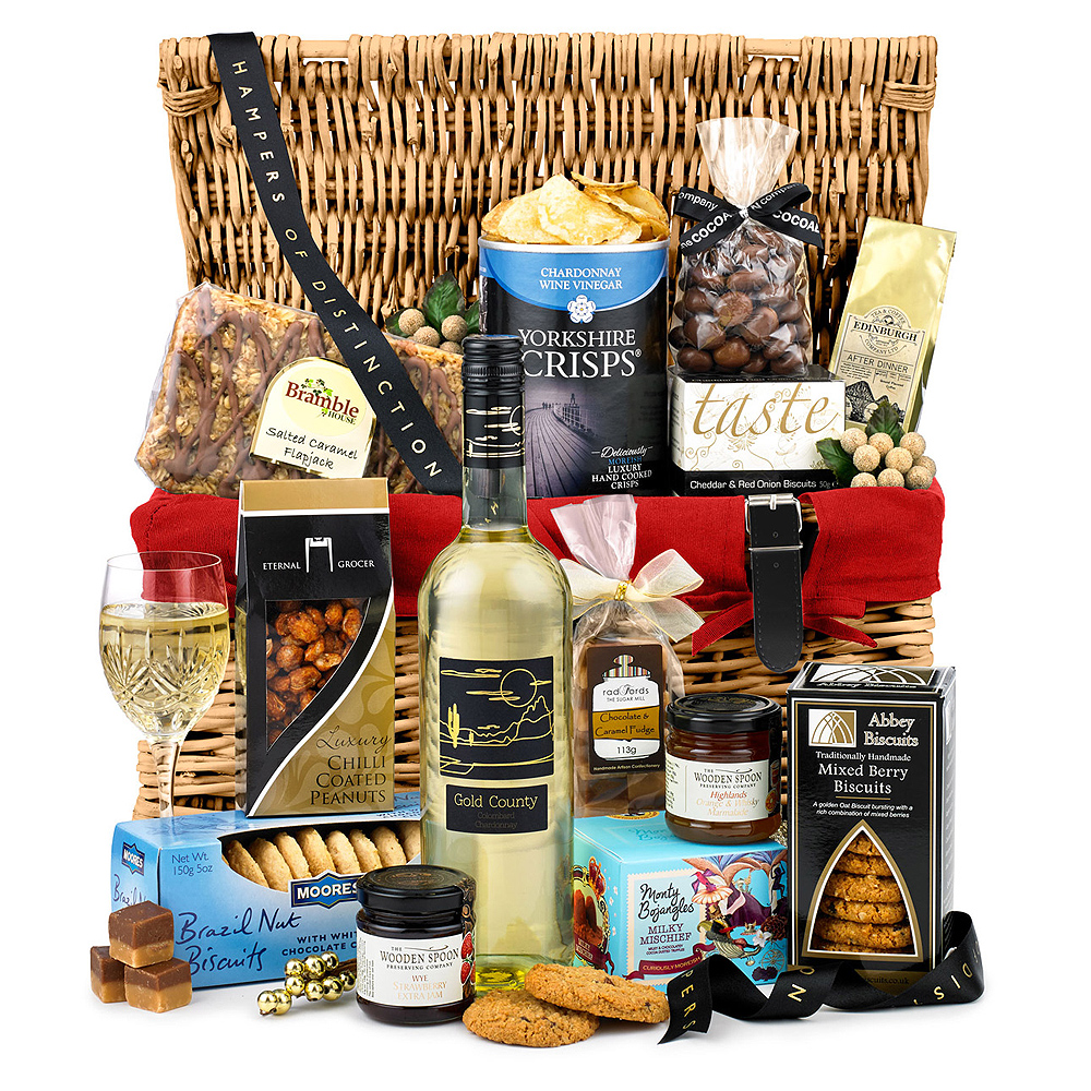 Image of A crisp and fruity bottle of Chardonnay joins a variety of tempting delights, from Brazil Nut Biscuits to Chilli Coated Peanuts and a Chocolate & Caramel Fudge Bag.