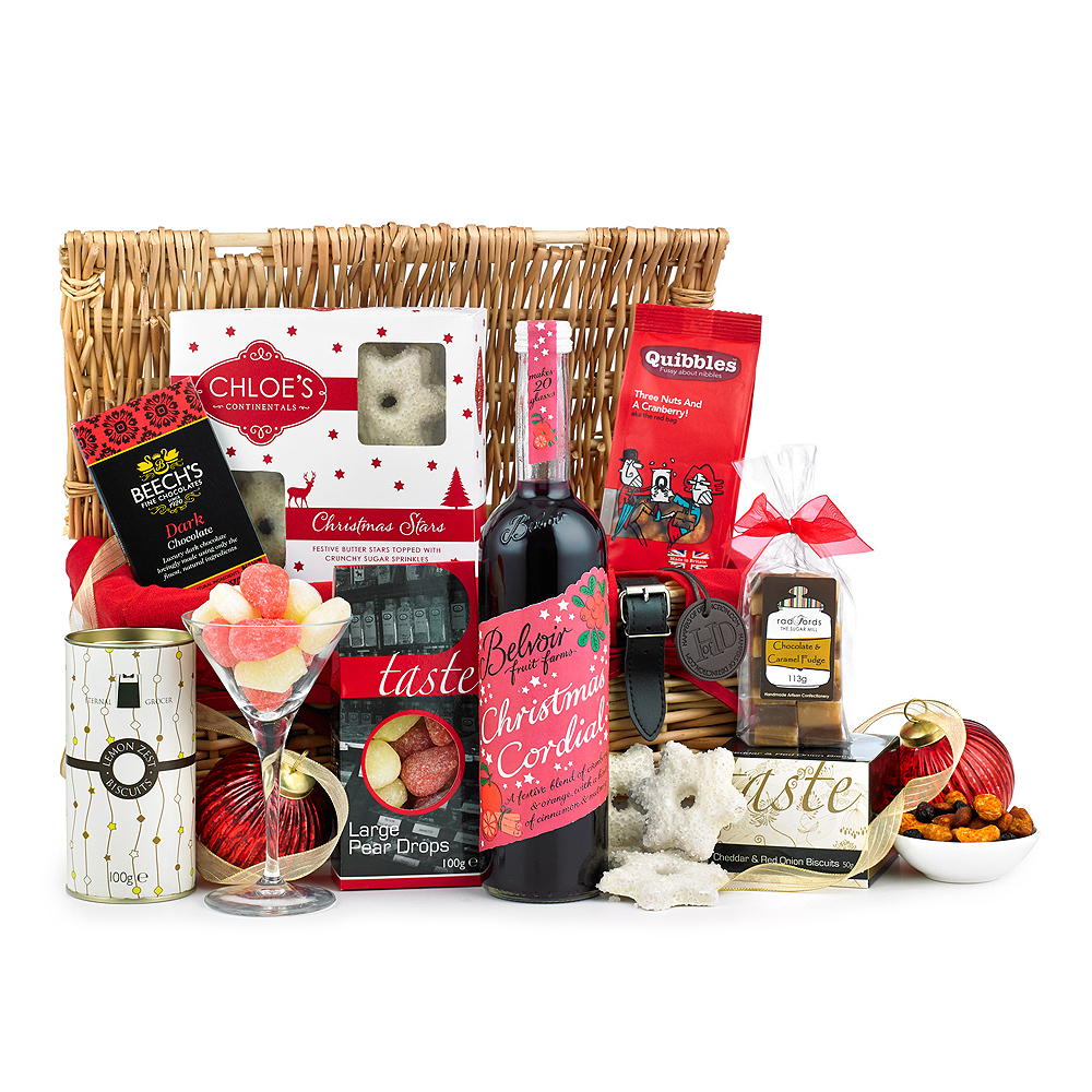 Image of Send your winter greetings to a loved one with this attractive wicker basket filled with items such as Christmas Cordial, West Country Fudge, Biscuits and more!