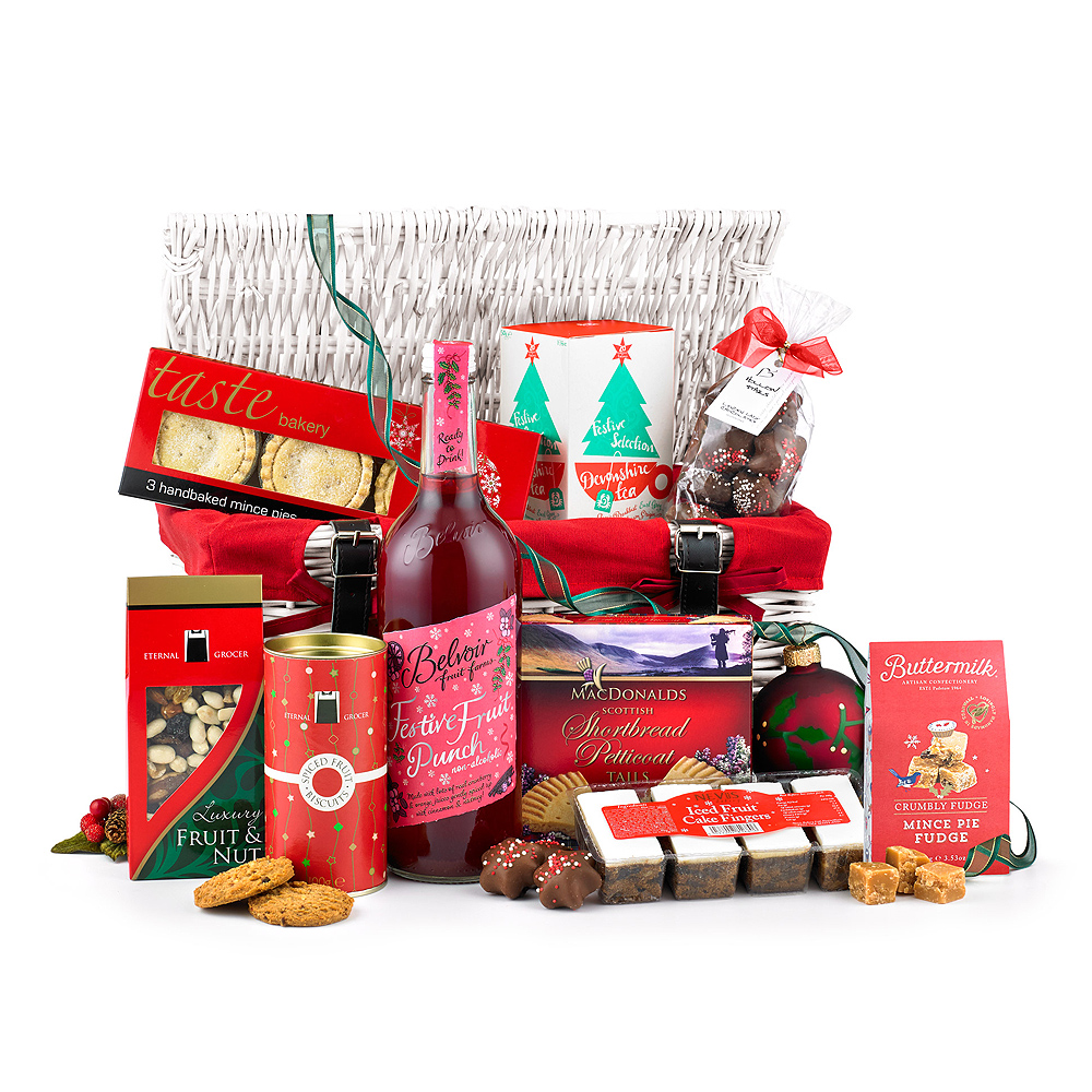 Image of Christmas mince pies, Scottish shortbread and Festive Fruit Punch are joined by a selection of tasty foods.Presented in a traditional white wicker suit case.